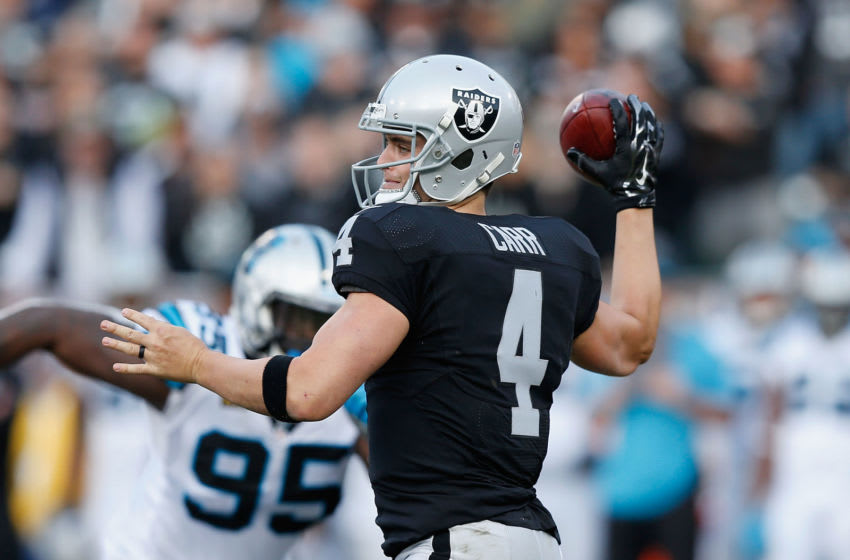 OAKLAND, CA - NOVEMBER 27: Derek Carr #4 of the Oakland Raiders passes the ball in the third quarter against the Carolina Panthers on November 27, 2016 in Oakland, California. (Photo by Lachlan Cunningham/Getty Images)