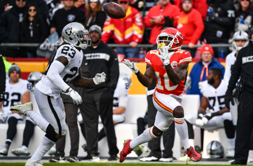 KANSAS CITY, MO - DECEMBER 30: Tyreek Hill #10 of the Kansas City Chiefs catches a pass in front of Nick Nelson #23 of the Oakland Raiders that would lead to the games first touchdown during the first quarter of the game at Arrowhead Stadium on December 30, 2018 in Kansas City, Missouri. (Photo by Peter Aiken/Getty Images)