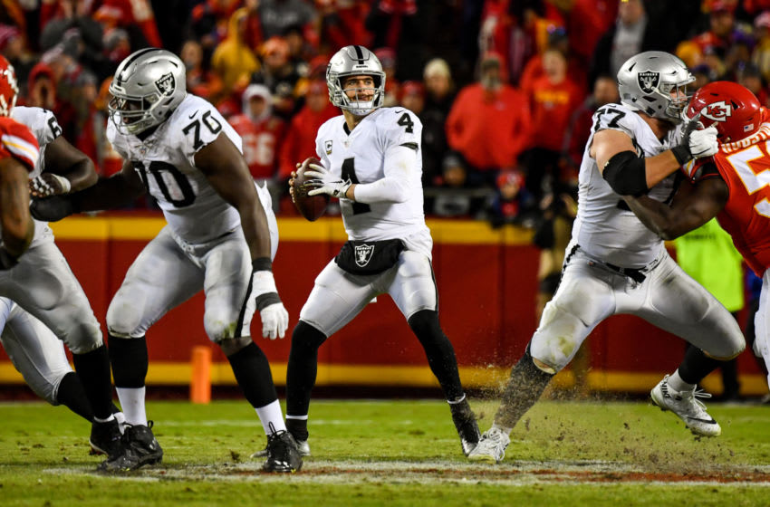 KANSAS CITY, MO - DECEMBER 30: Derek Carr #4 of the Oakland Raiders drops back to throw a pass during the second half of the game against the Kansas City Chiefs at Arrowhead Stadium on December 30, 2018 in Kansas City, Missouri. (Photo by Peter Aiken/Getty Images)