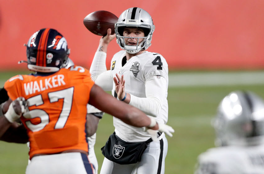 DENVER, COLORADO - JANUARY 03: Quarterback Derek Carr #4 of the Las Vegas Raiders throws against the Denver Broncos in the fourth quarter at Empower Field At Mile High on January 03, 2021 in Denver, Colorado. (Photo by Matthew Stockman/Getty Images)