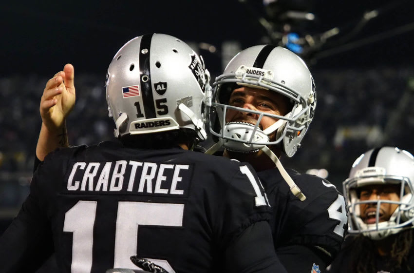 Dec 17, 2017; Oakland, CA, USA; Oakland Raiders wide receiver Michael Crabtree (15) celebrates with quarterback Derek Carr (4) after a touchdown against the Dallas Cowboys during the third quarter at Oakland Coliseum. Mandatory Credit: Kelley L Cox-USA TODAY Sports