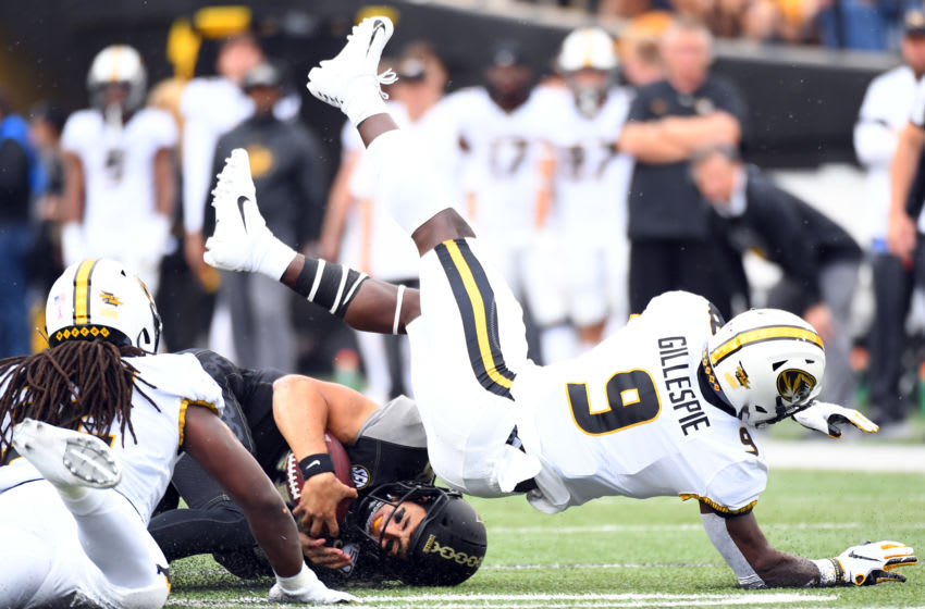 Oct 19, 2019; Nashville, TN, USA; Vanderbilt Commodores quarterback Mo Hasan (18) is tackled by Missouri Tigers safety Tyree Gillespie (9) after a first down during the first half at Vanderbilt Stadium. Mandatory Credit: Christopher Hanewinckel-USA TODAY Sports