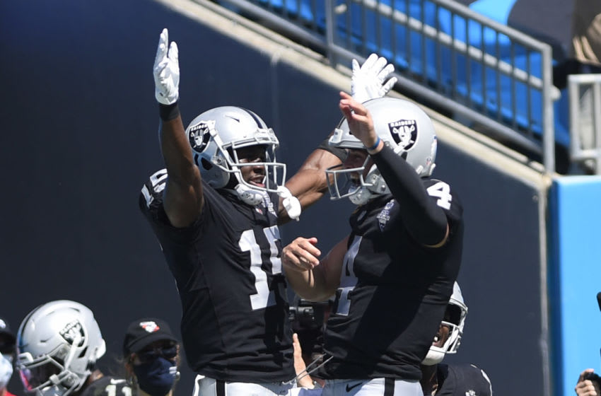 Sep 13, 2020; Charlotte, North Carolina, USA; Las Vegas Raiders wide receiver Nelson Agholor (15) celebrates with quarterback Derek Carr (4) after catching a touchdown in the second quarter at Bank of America Stadium. Mandatory Credit: Bob Donnan-USA TODAY Sports