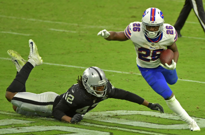 Oct 4, 2020; Paradise, Nevada, USA; Buffalo Bills running back Devin Singletary (26) shakes the tackle of Las Vegas Raiders inside linebacker Cory Littleton (42) during the fourth quarter at Allegiant Stadium. Mandatory Credit: Stephen R. Sylvanie-USA TODAY Sports