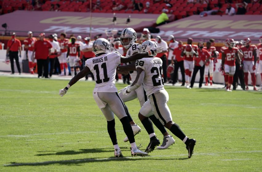 Oct 11, 2020; Kansas City, Missouri, USA; Las Vegas Raiders running back Josh Jacobs (28) celebrates with wide receiver Henry Ruggs III (11) and tight end Darren Waller (83) after scoring on a 2-yard touchdown run in the fourth quarter against the Kansas City Chiefsat Arrowhead Stadium. The Raiders defeated the Chiefs 40-32. Mandatory Credit: Kirby Lee-USA TODAY Sports