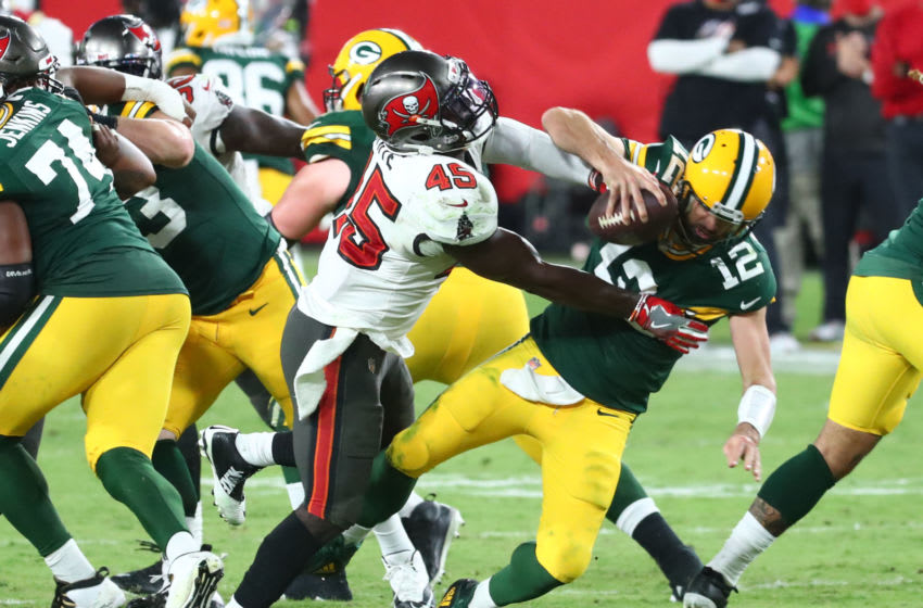 Oct 18, 2020; Tampa, Florida, USA; Green Bay Packers quarterback Aaron Rodgers (12) is sacked by Tampa Bay Buccaneers inside linebacker Devin White (45) during the fourth quarter of a NFL game at Raymond James Stadium. Mandatory Credit: Kim Klement-USA TODAY Sports