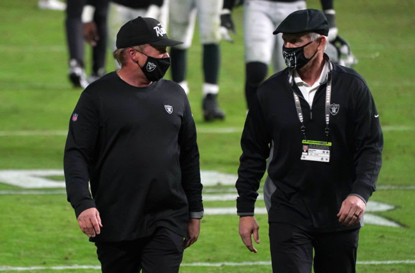 Nov 15, 2020; Paradise, Nevada, USA; Las Vegas Raiders coach Jon Gruden (left) and general manager Mike Mayock walk off the field after the game against the Denver Broncos at Allegiant Stadium. The Raiders defeated the Broncos 37-12. Mandatory Credit: Kirby Lee-USA TODAY Sports