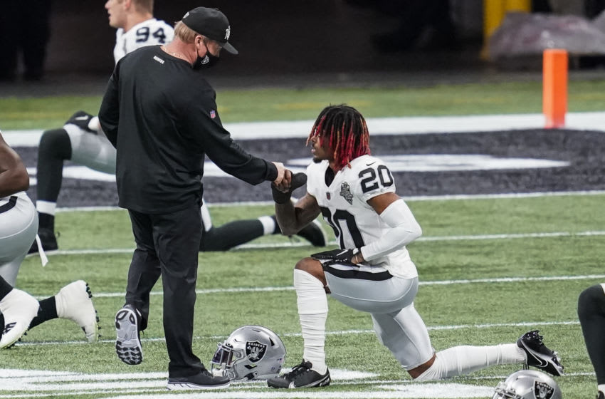 Nov 29, 2020; Atlanta, Georgia, USA; Las Vegas Raiders head coach John Gruden reacts with cornerback Damon Arnette (20) before a game against the Atlanta Falcons at Mercedes-Benz Stadium. Mandatory Credit: Dale Zanine-USA TODAY Sports