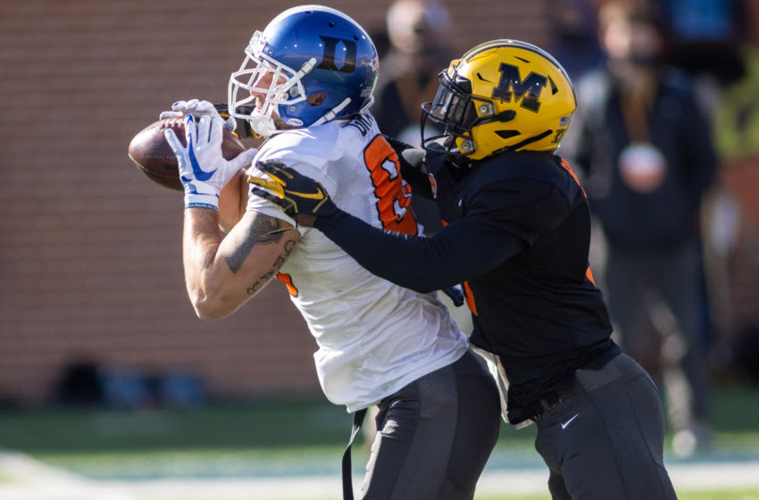Jan 28, 2021; American tight end Noah Gray of Duke (86) grabs a pass with American defensive back Tyree Gillespie of Missouri (3) defending during American practice at Hancock Whitney Stadium in Mobile, Alabama, USA; Mandatory Credit: Vasha Hunt-USA TODAY Sports