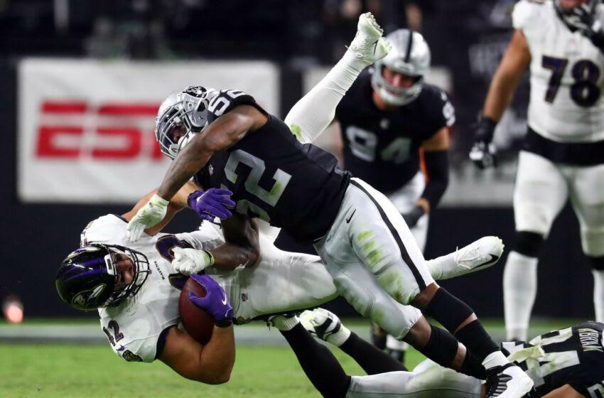 Sep 13, 2021; Paradise, Nevada, USA; Baltimore Ravens fullback Patrick Ricard (42) is brought down by Las Vegas Raiders linebacker Denzel Perryman (52) during the second half at Allegiant Stadium. Mandatory Credit: Mark J. Rebilas-USA TODAY Sports