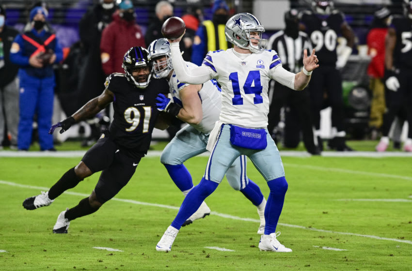 Dec 8, 2020; Baltimore, Maryland, USA; Dallas Cowboys quarterback Andy Dalton (14) throws as Baltimore Ravens defensive end Yannick Ngakoue (91) rushes during the first quarter at M&T Bank Stadium. Mandatory Credit: Tommy Gilligan-USA TODAY Sports