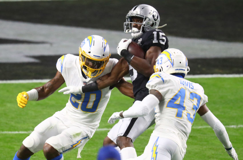 Dec 17, 2020; Paradise, Nevada, USA; Las Vegas Raiders wide receiver Nelson Agholor (15) moves the ball against Los Angeles Chargers safety Jaylen Watkins (20) and cornerback Michael Davis (43) during the first half at Allegiant Stadium. Mandatory Credit: Mark J. Rebilas-USA TODAY Sports