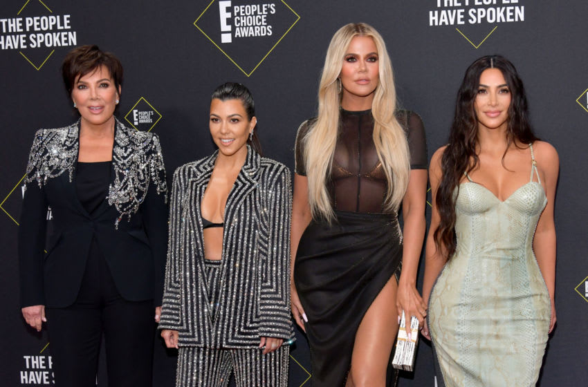 Kris Jenner, Kourtney Kardashian, Khloé Kardashian and Kim Kardashian attend the E! People's Choice Awards (Photo by Frazer Harrison/Getty Images)
