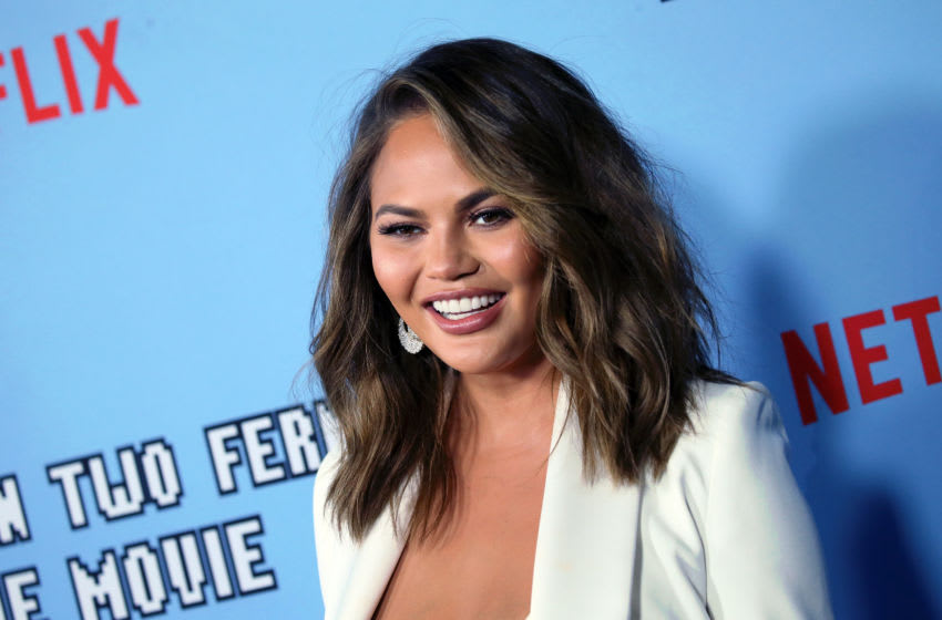 Chrissy Teigen graciously gifted Kourtney Kardashian with a Cravings gift basket (Photo by David Livingston/Getty Images)