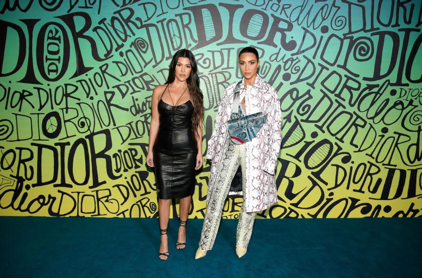 Kourtney Kardashian and Kim Kardashian West attend the Dior Men's Fall 2020 Runway Show (Photo by Dimitrios Kambouris/Getty Images for Dior Men)
