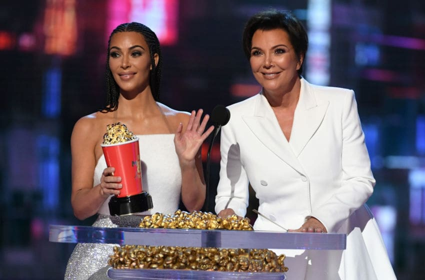 SANTA MONICA, CA - JUNE 16: TV personalities Kim Kardashian (L) and Kris Jenner accept the Best Reality Series or Franchise award for 'Keeping Up with the Kardashians' onstage during the 2018 MTV Movie And TV Awards at Barker Hangar on June 16, 2018 in Santa Monica, California. (Photo by Kevin Winter/Getty Images for MTV)