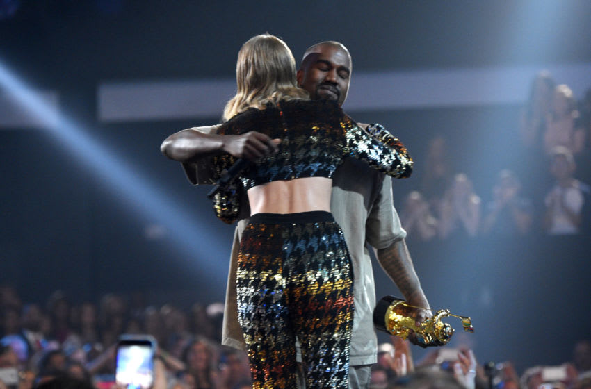 LOS ANGELES, CA - AUGUST 30: Recording artist Taylor Swift (L) hugs recording artist Kanye West after presenting him with the Vanguard Award onstage during the 2015 MTV Video Music Awards at Microsoft Theater on August 30, 2015 in Los Angeles, California. (Photo by Larry Busacca/MTV1415/Getty Images)
