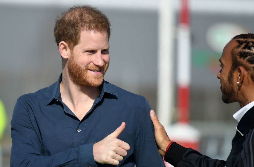 Britain's Prince Harry, Duke of Sussex (L) gestures to Britain's Formula One world champion driver Lewis Hamilton (R) as they leave after a visit to officially open the Silverstone Experience at Silverstone motor racing circuit, in central England on March 6, 2020. - The Silverstone Experience is the new home to the archive of the British Racing Drivers Club. The museum brings the extensive heritage of Silverstone and British motor racing to life through a dynamic, interactive and educational visitor experience. (Photo by DANIEL LEAL-OLIVAS / AFP) (Photo by DANIEL LEAL-OLIVAS/AFP via Getty Images)