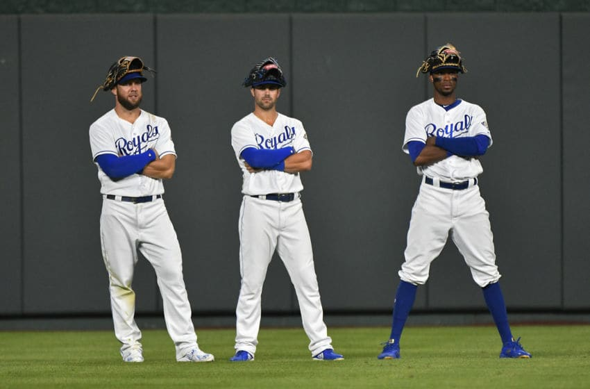 KANSAS CITY, MO - AUGUST 6: Alex Gordon #4, Whit Merrifield #15 and Rosell Herrera #7 of the Kansas City Royals stand in the outfield as they wait through a pitching change in the eighth inning against the Chicago Cubs at Kauffman Stadium on August 6, 2018 in Kansas City, Missouri. (Photo by Ed Zurga/Getty Images)