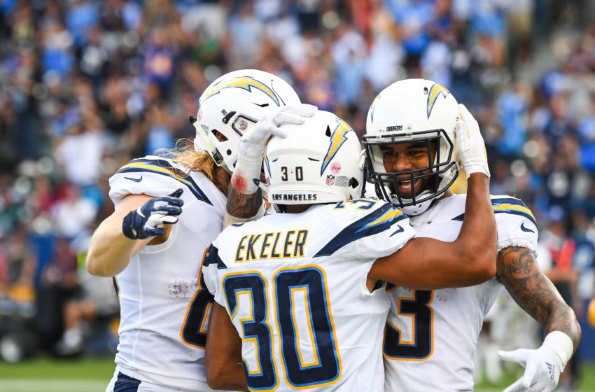 Running back Austin Ekeler #30 of the Los Angeles Chargers celebrates his touchdown with tight end Sean Culkin #80 and wide receiver Keenan Allen #13 in the second quarter against the San Francisco 49ers at StubHub Center on September 30, 2018 in Carson, California. (Photo by Jayne Kamin-Oncea/Getty Images)