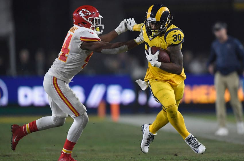 Todd Gurley #30 of the Los Angeles Rams fends off Dorian O'Daniel #44 of the Kansas City Chiefs \(Photo by Kevork Djansezian/Getty Images)
