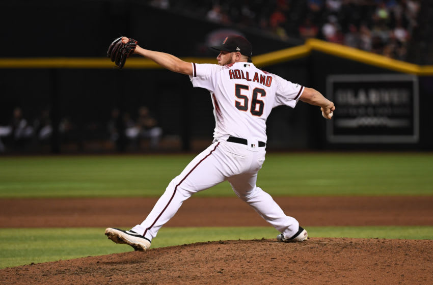 PHOENIX, ARIZONA - JULY 24: Greg Holland #56 of the Arizona Diamondbacks delivers a ninth inning pitch against the Baltimore Orioles at Chase Field on July 24, 2019 in Phoenix, Arizona. Diamondbacks won 5-2 and it was Lopez's first MLB save. (Photo by Norm Hall/Getty Images)