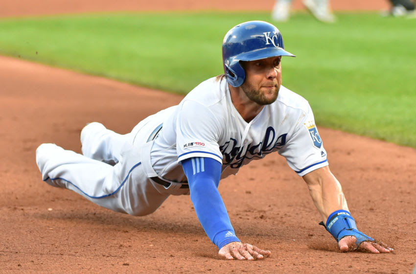 KANSAS CITY, MISSOURI - AUGUST 17: Alex Gordon #4 of the Kansas City Royals slides into third as he advances on a Hunter Dozier single in the fourth inning against the New York Mets at Kauffman Stadium on August 17, 2019 in Kansas City, Missouri. (Photo by Ed Zurga/Getty Images)