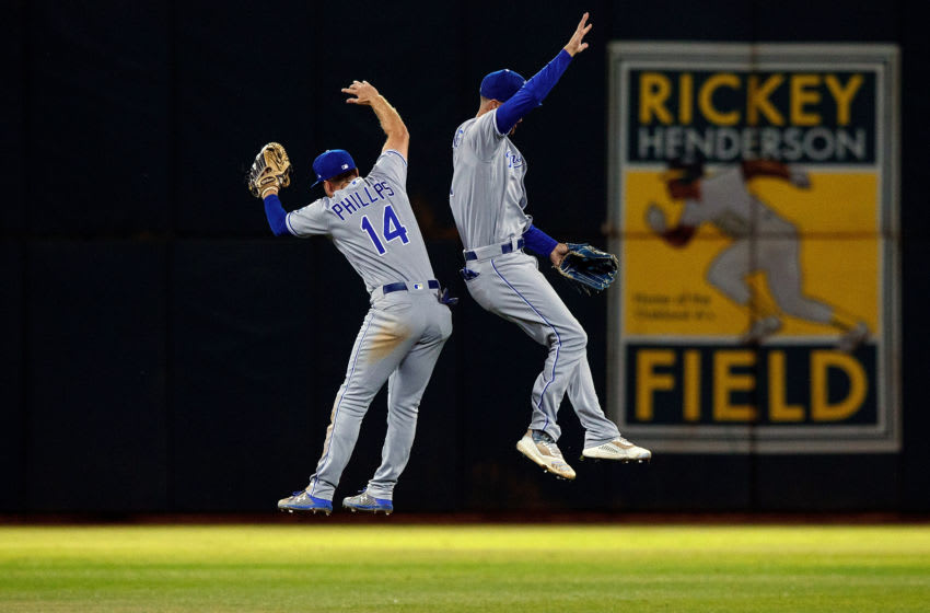 OAKLAND, CA - SEPTEMBER 16: Brett Phillips #14 of the Kansas City Royals celebrates with Bubba Starling #11 after the game against the Oakland Athletics at the RingCentral Coliseum on September 16, 2019 in Oakland, California. The Kansas City Royals defeated the Oakland Athletics 6-5. (Photo by Jason O. Watson/Getty Images)