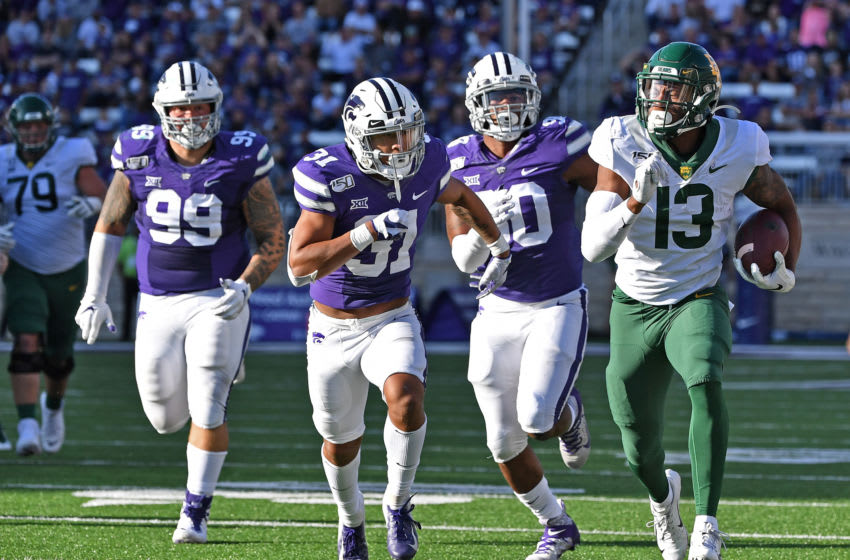 MANHATTAN, KS - OCTOBER 05: Wide receiver R.J. Sneed #13 of the Baylor Bears rushes up field after catching a pass against defensive back Jahron McPherson #31 of the Kansas State Wildcats during the second half at Bill Snyder Family Football Stadium on October 5, 2019 in Manhattan, Kansas. (Photo by Peter G. Aiken/Getty Images)