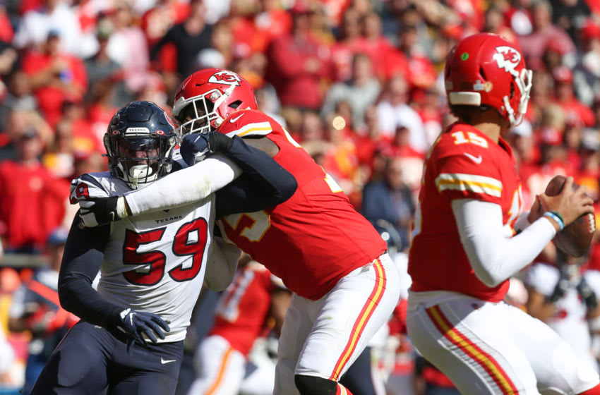 KANSAS CITY, MO - OCTOBER 13: Kansas City Chiefs offensive tackle Cameron Erving (75) hooks Houston Texans outside linebacker Whitney Mercilus (59) during a pass block in the third quarter of an NFL matchup between the Houston Texans and Kansas City Chiefs on October 13, 2019 at Arrowhead Stadium in Kansas City, MO. (Photo by Scott Winters/Icon Sportswire via Getty Images)