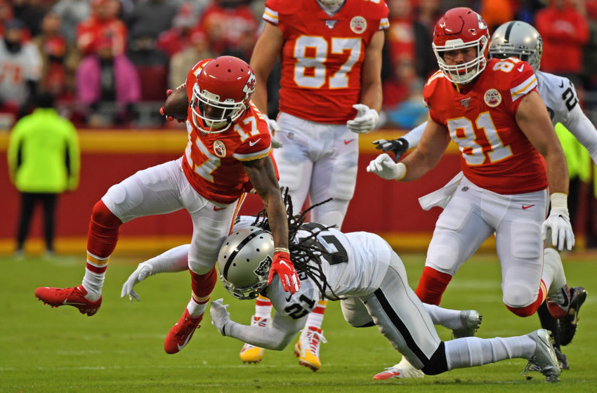 KANSAS CITY, MO - DECEMBER 01: Free safety D.J. Swearinger #21 of the Oakland Raiders tackles wide receiver Sammy Watkins #14 of the Kansas City Chiefs during the first half at Arrowhead Stadium on December 1, 2019 in Kansas City, Missouri. (Photo by Peter Aiken/Getty Images)