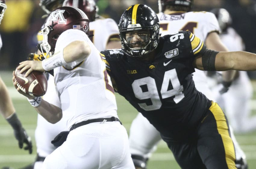 IOWA CITY, IOWA- NOVEMBER 16: Defensive end A.J. Epenesa #94 of the Iowa Hawkeyesputs pressure during the second half on quarterback Tanner Morgan #2 of the Minnesota Gophers on November 16, 2019 at Kinnick Stadium in Iowa City, Iowa. (Photo by Matthew Holst/Getty Images)