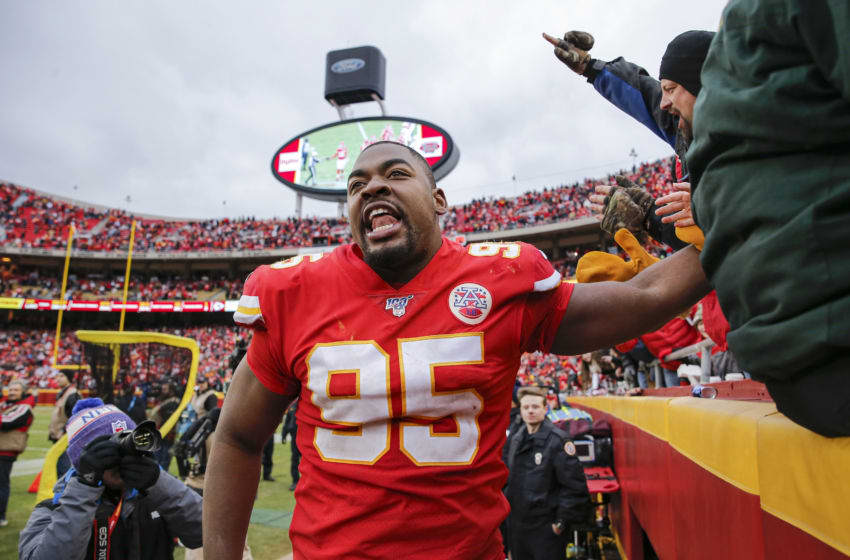 KANSAS CITY, MO - DECEMBER 29: Chris Jones #95 of the Kansas City Chiefs celebrated with fans following the news that the Chiefs ended with the No. 2 seed in the AFC following the 31-21 win over the Los Angeles Chargers at Arrowhead Stadium on December 29, 2019 in Kansas City, Missouri. (Photo by David Eulitt/Getty Images)