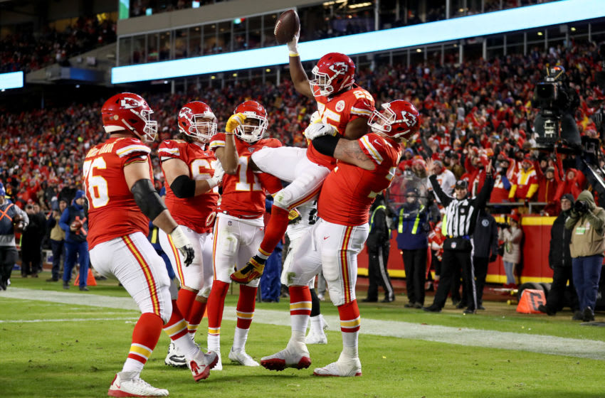 KANSAS CITY, MISSOURI - DECEMBER 01: LeSean McCoy #25 of the Kansas City Chiefs celebrates with his teammates after scoring a 3 yard touchdown during the third quarter in the game at Arrowhead Stadium on December 01, 2019 in Kansas City, Missouri. (Photo by Jamie Squire/Getty Images)