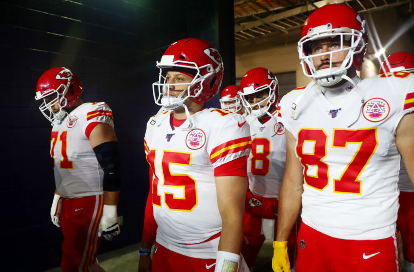 FOXBOROUGH, MASSACHUSETTS - DECEMBER 08: Patrick Mahomes #15 and Travis Kelce #87 of the Kansas City Chiefs prepare to take the field against the New England Patriots before the game at Gillette Stadium on December 08, 2019 in Foxborough, Massachusetts. (Photo by Adam Glanzman/Getty Images)