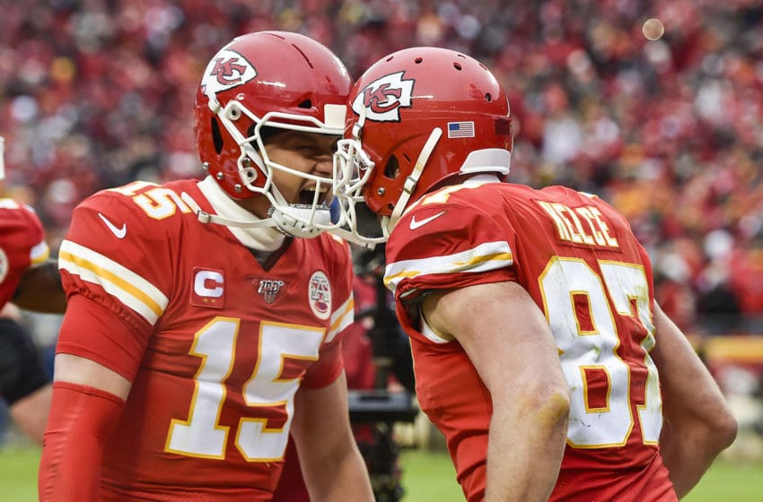 Kansas City Chiefs quarterback Patrick Mahomes and tight end Travis Kelce celebrate after Kelce scored a second touchdown in the second quarter on a pass from Mahomes against the Houston Texans Sunday, Jan. 12, 2020, at Arrowhead Stadium in Kansas City, Mo. (Jill Toyoshiba/Kansas City Star/Tribune News Service via Getty Images)