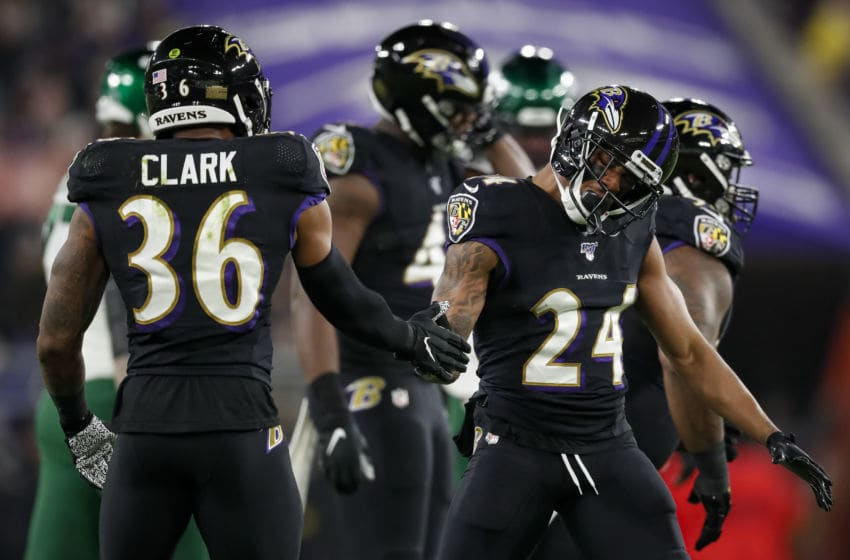 BALTIMORE, MD - DECEMBER 12: Marcus Peters #24 of the Baltimore Ravens celebrates with Chuck Clark #36 after a play against the New York Jets during the first half at M&T Bank Stadium on December 12, 2019 in Baltimore, Maryland. (Photo by Scott Taetsch/Getty Images)