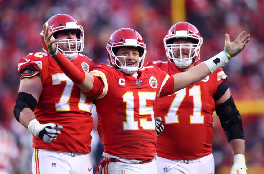 Patrick Mahomes #15 of the Kansas City Chiefs reacts with teammates Eric Fisher #72 and Mitchell Schwartz #71 after a fourth quarter touchdown pass (Photo by Jamie Squire/Getty Images)