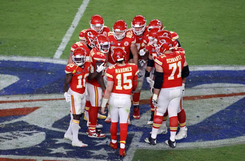 MIAMI, FLORIDA - FEBRUARY 02: Kansas City Chiefs huddle in Super Bowl LIV -aat Hard Rock Stadium on February 02, 2020 in Miami, Florida. (Photo by Elsa/Getty Images)