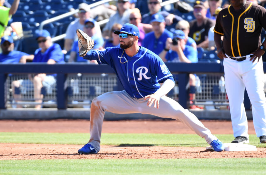 PEORIA, ARIZONA - MARCH 04: Ryan McBroom #9 of the Kansas City Royals catches a throw while covering first base against the San Diego Padres during a spring training game on March 04, 2020 in Peoria, Arizona. (Photo by Norm Hall/Getty Images)