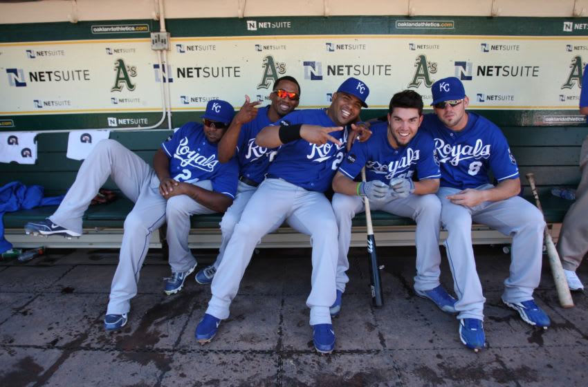 OAKLAND, CA - SEPTEMBER 7: Yamaico Navarro #24, Alcides Escobar #2, Brayan Pena #27, Eric Hosmer #35 and Mike Moustakas #8 of the Kansas City Royals joke around in the dugout prior to the game against the Oakland Athletics at the Oakland-Alameda County Coliseum on September 7, 2011 in Oakland, California. The Athletics defeated the Royals 7-0. (Photo by Michael Zagaris/Oakland Athletics/Getty Images)