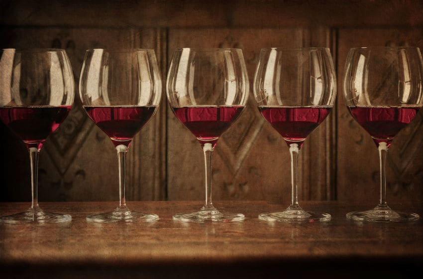 Textured image: Large red wine glasses in a row (Photo by Steve Lupton/Corbis via Getty Images)