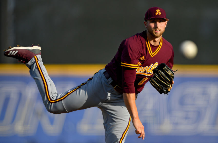 SEATTLE, WASHINGTON - APRIL 26: Alec Marsh #8 of the Arizona State Sun Devils delivers a pitch to the Washington Huskies at Husky Ballpark on April 26, 2019 in Seattle, Washington. Early offense holds up as the Washington Huskies defeat the No. 15 Arizona State Sun Devils, 10-6, to win game one of the three-game series. (Photo by Alika Jenner/Getty Images)