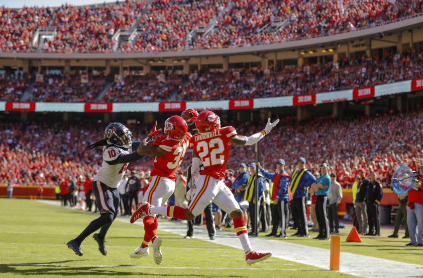 KANSAS CITY, MO - OCTOBER 13: Charvarius Ward #35 of the Kansas City Chiefs intercepts a pass intended for DeAndre Hopkins #10 of the Houston Texans in the third quarter at Arrowhead Stadium on October 13, 2019 in Kansas City, Missouri. Juan Thornhill #22 of the Kansas City Chiefs assists in the defensive coverage. (Photo by David Eulitt/Getty Images)