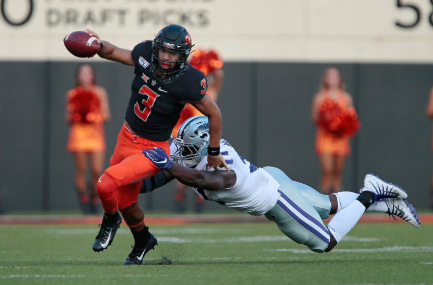 STILLWATER, OK - SEPTEMBER 28: Defensive end Reggie Walker #51 of the Kansas State Wildcats dives for quarterback Spencer Sanders #3 of the Oklahoma State Cowboys in the first quarter on September 28, 2019 at Boone Pickens Stadium in Stillwater, Oklahoma. OSU won 26-13. (Photo by Brian Bahr/Getty Images)
