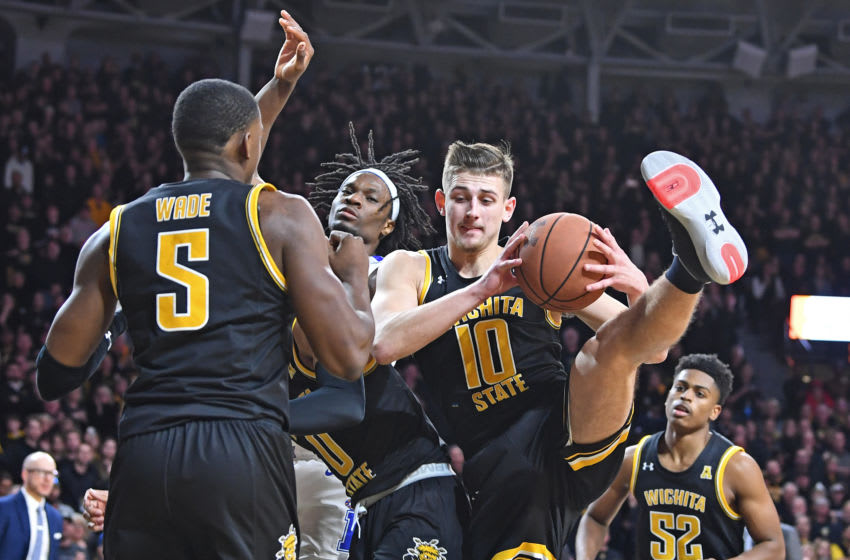 WICHITA, KS - JANUARY 09: Erik Stevenson #10 of the Wichita State Shockers pulls down a defensive rebound during the second half against the Memphis Tigers on January 9, 2020 at Charles Koch Arena in Wichita, Kansas. (Photo by Peter G. Aiken/Getty Images)