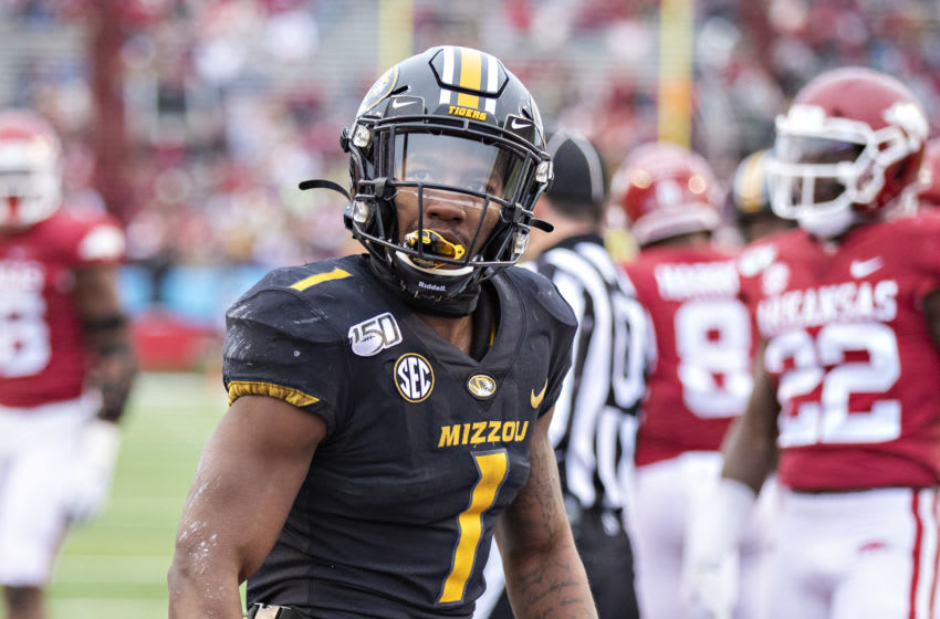LITTLE ROCK, AR - NOVEMBER 29: Tyler Badie #1 of the Missouri Tigers celebrates after scoring a touchdown during a game against the Arkansas Razorbacks at War Memorial Stadium on November 29, 2019 in Little Rock, Arkansas The Tigers defeated the Razorbacks 24-14. (Photo by Wesley Hitt/Getty Images)