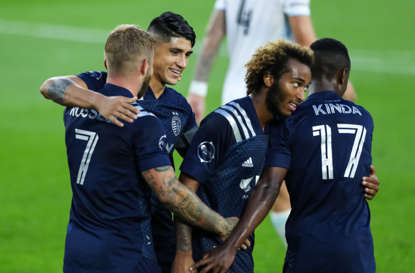 MINNEAPOLIS, MINNESOTA - AUGUST 21: Johnny Russell #7, Alan Pulido #9, Gianluca Busio #27, and Gadi Kinda #17 of Sporting Kansas City celebrate after an own goal committed by Michael Boxall #15 of Minnesota United (not pictured) in the second half of the game at Allianz Field on August 21, 2020 in St Paul, Minnesota. Sporting Kansas City defeated Minnesota United 2-1. (Photo by David Berding/Getty Images)