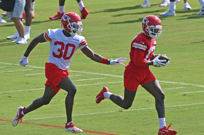 ST JOSEPH, MISSOURI - JULY 28: Wide receiver Mecole Hardman #17 of the Kansas City Chiefs catches a pass against defensive back Deandre Baker #30, during training camp at Missouri Western State University on July 28, 2021 in St Joseph, Missouri. (Photo by Peter Aiken/Getty Images)