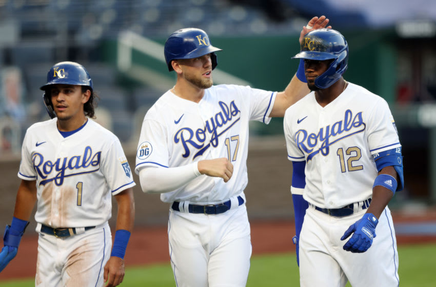 KANSAS CITY, MISSOURI - AUGUST 21: Jorge Soler #12 of the Kansas City Royals is congratulated by Hunter Dozier #17 and Nicky Lopez #1 after hitting a 3-run home run during the 1st inning of the game against the Minnesota Twins at Kauffman Stadium on August 21, 2020 in Kansas City, Missouri. (Photo by Jamie Squire/Getty Images)